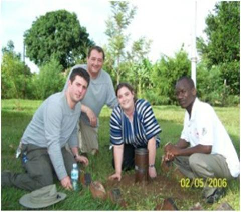 Co-founders of DRIP Keith Wylde (centre), son-in-law Dr Andrew Herod  and his wife Kate with a Ugandan volunteer.
