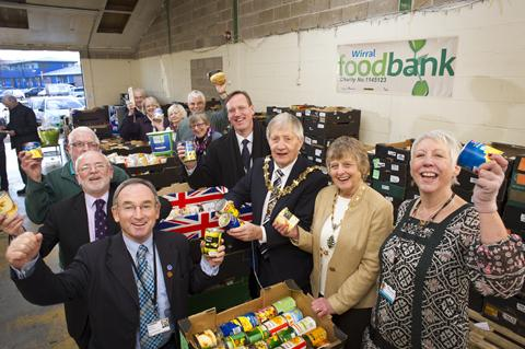 Jayne Branch-Murray (front right) joins supporters and volunteers at the Foodbank in Birkenhead for a first year celebration.