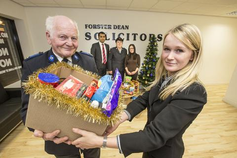 Pictured handing over the hamper to Robin Wray is Victoria Hepworth from Forster Dean. Behind them are from left to right Mofozzul Hussain, Barbara Wray and Alicia Friel.