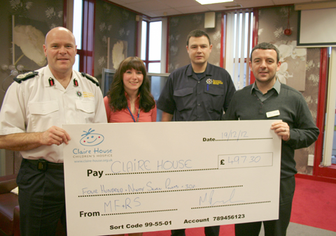 Chief Fire Officer Dan Stephens, on far left, Information Analyst Michelle Rasdale, Arson Reduction Advocate Michael Buratti, who were both part of the dragon boat team, and Tony Langan Area Fundraiser for Claire House Children's Hospice. Picture: MFRS
