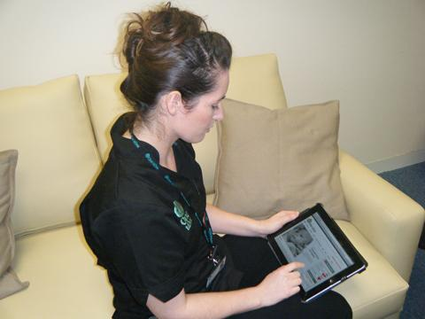 PRAISE: Midwife Leanne Rendell uses the latest technology to respond to a mum-to-be.