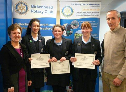 Junior Winning Team - Wirral Grammar School for Girls students from left to right: Kira Stalker, Ellie Johnson and Rosabelle Bennett, with Principal of Birkenhead Sixth Form College, Kathryn Podmore, and Peter D