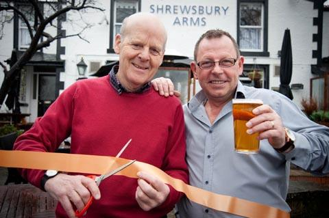 Steve Ferguson helps general Ronnie Karlsen celebrate the Shrewsbury Arms' reopening