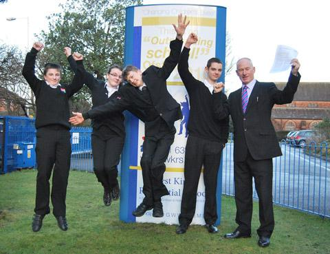 Gareth Williams and pupils celebrate school's success.