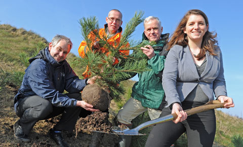 Pictured from left is Mike Parr from The Land Trust, Peter Lunt (Biffa) and Keith Jones (Forestry Commission) with MP Alison McGovern. Picture: Paul Heaps