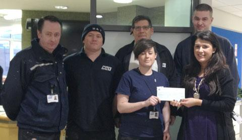 The attached photo shows the M&Y team handing over their donation at Clatterbridge.