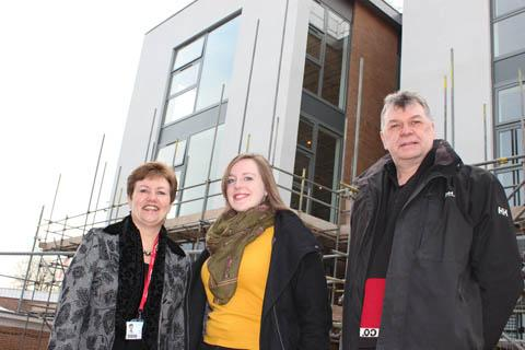 Kathryn Podmore, Rachel Clegg and Steve Geary outside the new building.