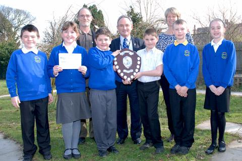 The winning team from Brookdale receive their shield from Cllr Brian Kenny and Peter Exley from the Wirral Environmental Network