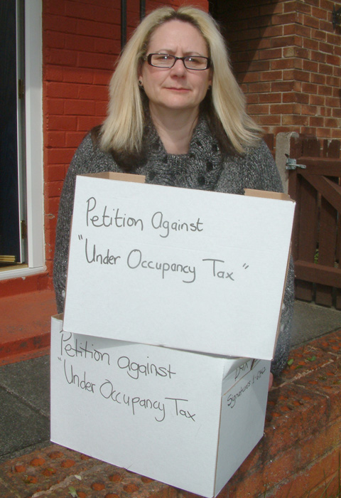 Dawn Thomas with the boxes of petitions