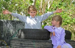 WIRRAL children have taken the classroom outdoors thanks to a collection of old pans, logs and plastic bottles.