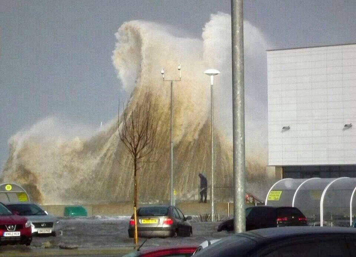Wall of water: A massive wave crashes into Morrison's. Picture: Nigel Bratley.