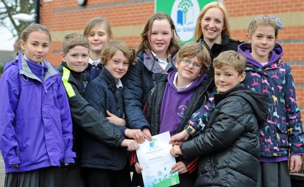 Mount Primary School in Wallasey celebrate their new Eco School status. Pictured are members of the eco team with deputy headteacher, Clare Higgins.