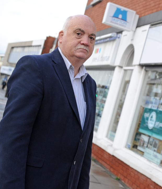 Wirral Globe: Cllr Chris Blakeley outside Moreton's Skipton branch. Picture: Paul Heaps