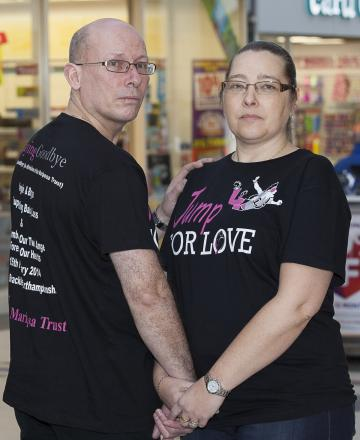 Angie and Bryan Walters are pictured at Pyramids Shopping Centre In Birkenhead ahead of their sky dive.