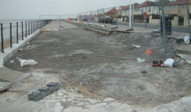 Signs of work underway to repair storm damage on Meols promenade.