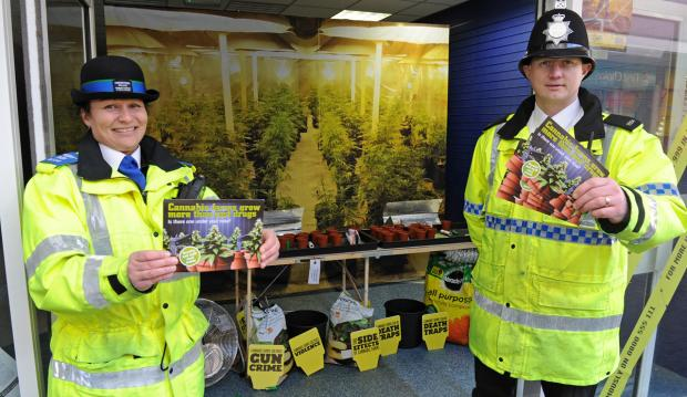 "Wirral Globe: PCSO Claire Sopp and Constable Charlie Farley at the ""pop-up"" cannabis farm in Liscard."