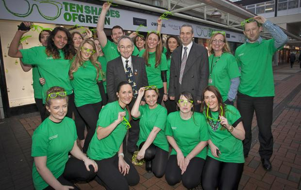The 10 shades of Green team pictured with Councillor Brian Kenny, Wirral Council's Cabinet Member for the Environment, (left) and Derek Millar, Commercial Director for Pyramids Shopping Centre.