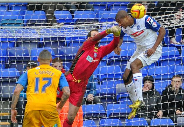 Wirral Globe: Stephen Arthurworrey helps owain Von Williams clear of the line for Tranmere Rovers V PNE. Picture: Paul Heaps