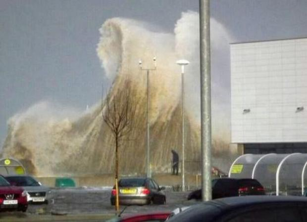Wirral Globe: FLASHBACK: Tidal wave rises above Morrisons on December 5. Picture by Nigel Bratley