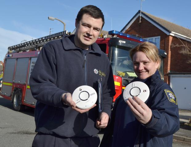 Mike Buratti, arson reduction officer, and crew manager Helen Pedersen during fire safety near Village Way in Wallasey. Picture: MF&RS