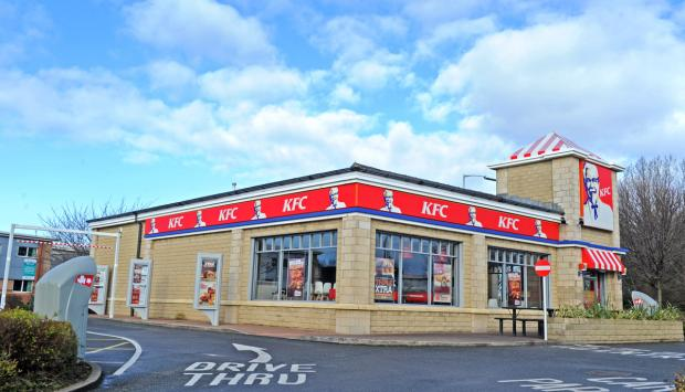 Man arrested after hammer raid at Birkenhead fast-food store