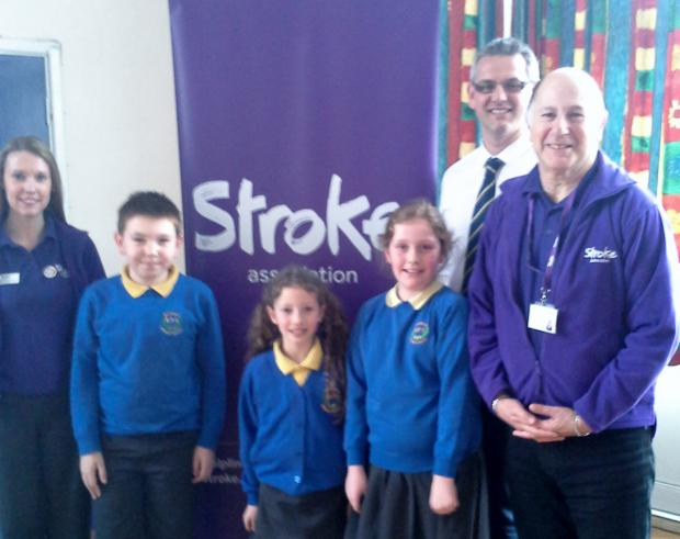 Julian Fisher with pupils and staff at Brookdale Primary School