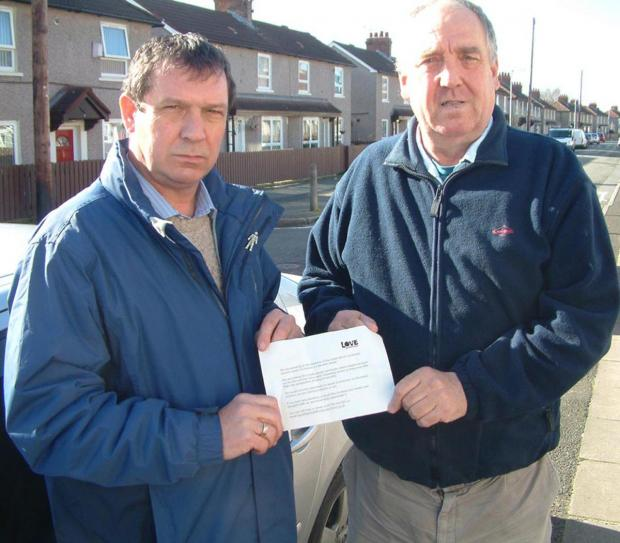 Wirral Globe: Cllr Jim Crabtree and Frank Harrison with copy of letter sent to residents in Fairbrook Drive last week