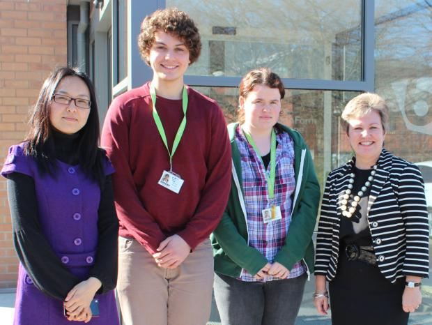 From left are Yanfang Si with Mandarin students Mateus Peters and Kim Butler and Principal Kathryn Podmore