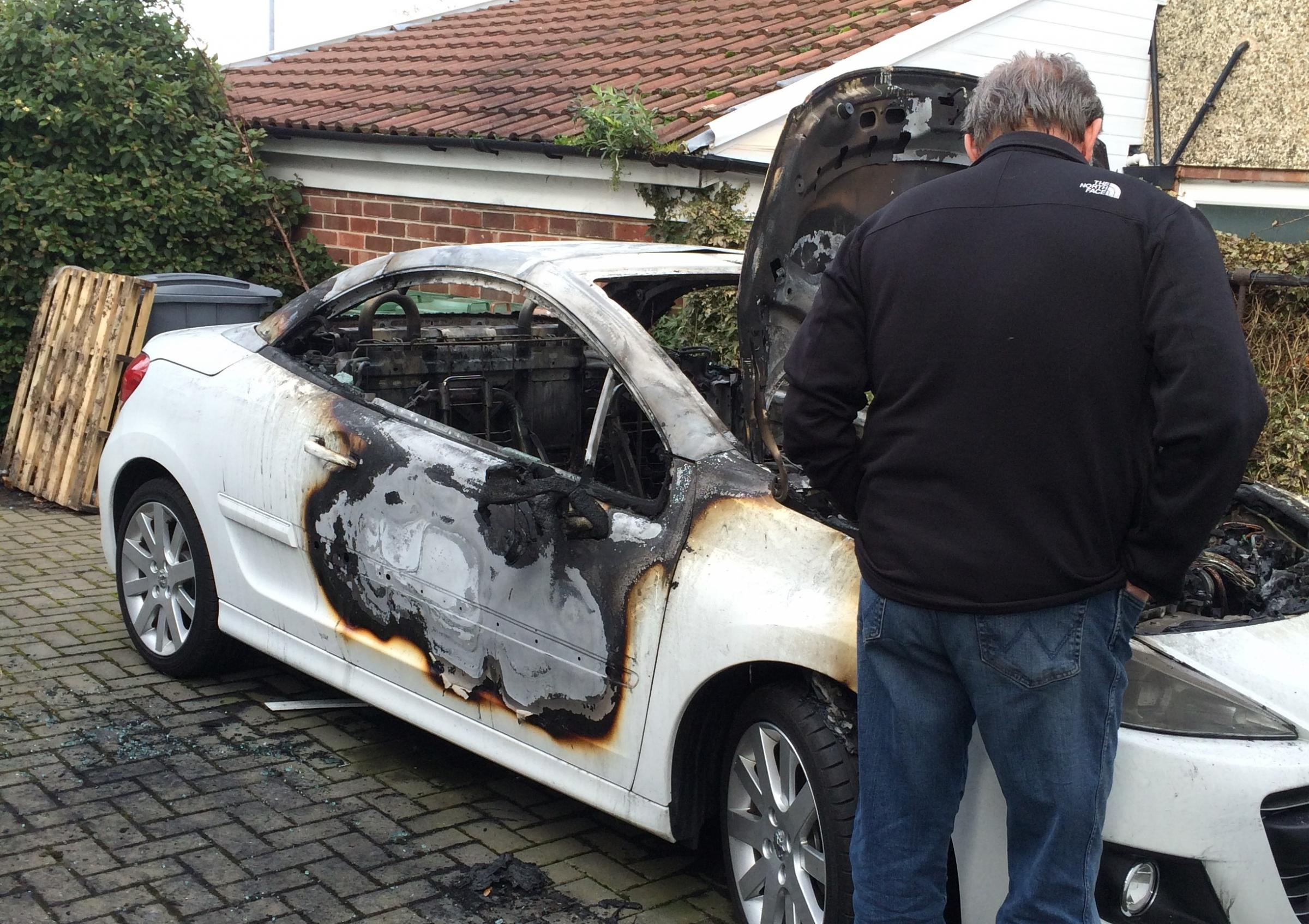 EXCLUSIVE: Barking dogs saved Wirral man's life as arsonists torched car on his drive
