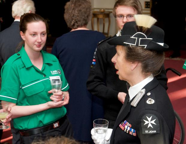 Rachael Hughes meets The Princess Royal during event at Buckingham Palace.