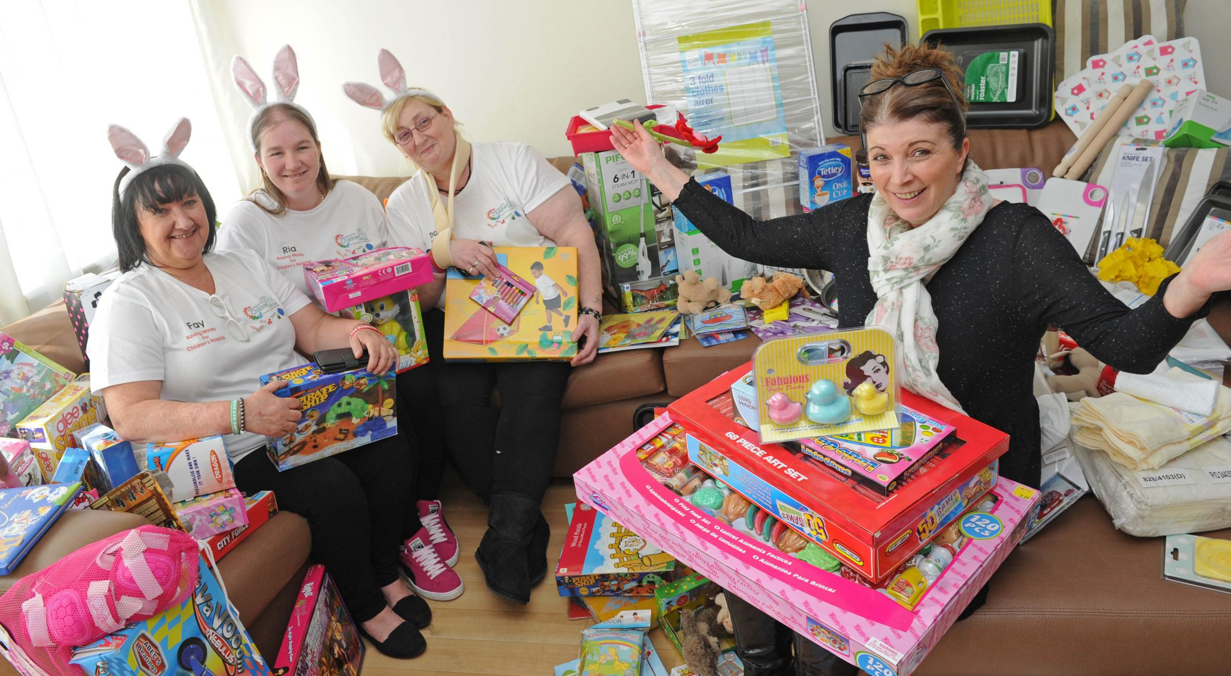 Wirral trio Tracey Bleasdale, Ria Cairns and Fay Murphy present dozens of toys, pots, pans and supplies to Ronald McDonald House Arrowe Park's manager, Cathy Churchill.