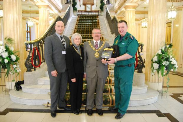 Gareth Roberts from Wirral Council's health and safety team, mayor and mayoress Sue and Dave Mitchell, and Rob Hussey from North West Ambulance Service.