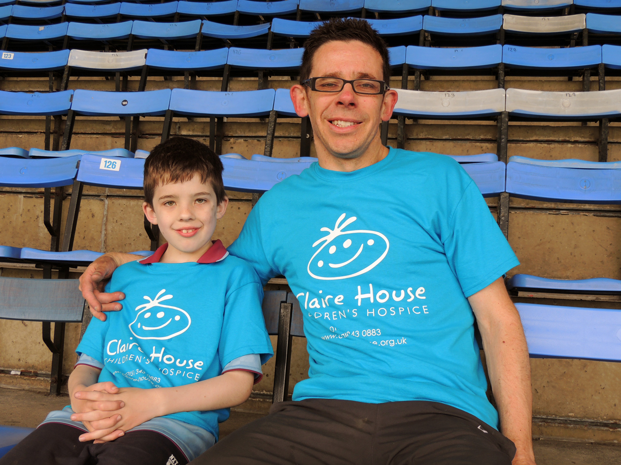 VIDEO: Wirral father and son tackle Prenton Park's 17,000 seats for Claire House
