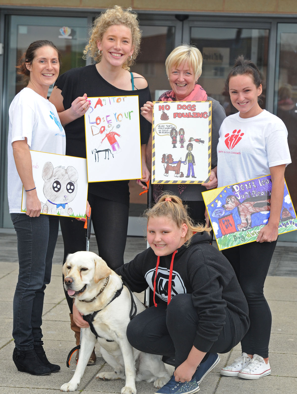 Jenni Jones, Sammy Barker, Sandra Camello, Sasha Mathias and Tiffany Barnes with Spencer the dog with some of the posters designed by schoolchildren.