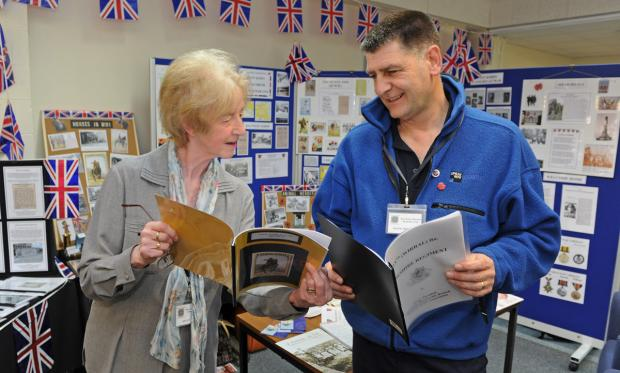 Helen Carr and Frank Sherratt with the WWI display at West Kirby Library.