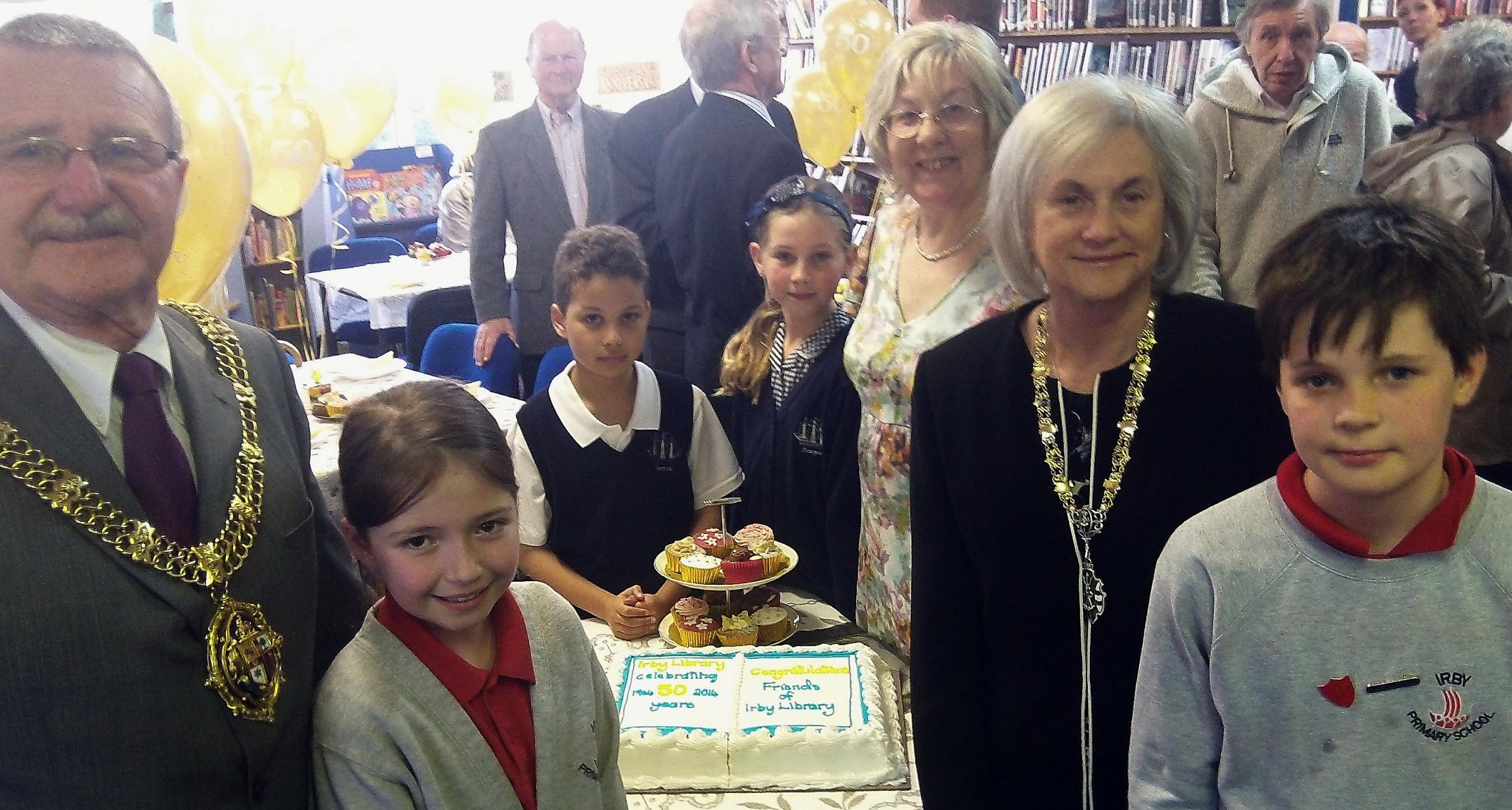 Mayor and mayoress, Cllr Dave and Sue Mitchell, with children from Irby and Dawpool Primary schools with Jacqueline McKelvie at this afternoon's tea party. Picture: Craig Manning