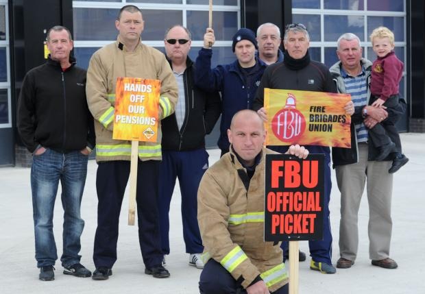 Firefighters strike outside Birkenhead fire station earlier this year.