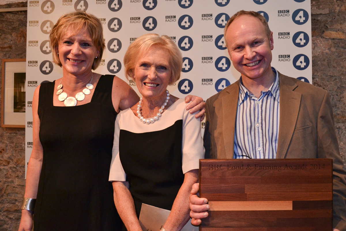 Debbie and Callum Edge are presented with their award by celebrity baker Mary Berry.