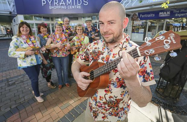 Wirral Globe: Ukulele orchestra members Kev Founds (front), Pat Ross,  Emma Owen, Sheila Coventry, Tom Baker, Jean Pound and Patrick McCarthy.