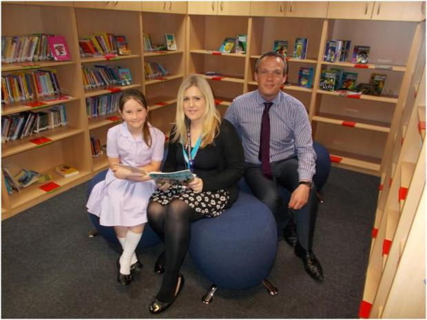 Wirral Globe: Headteacher Mr Cassidy, Beanstalk volunteer Leanne Holden and pupil Sophia Platt.