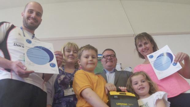 Staff and pupils from Woodslee Primary with Mark King
