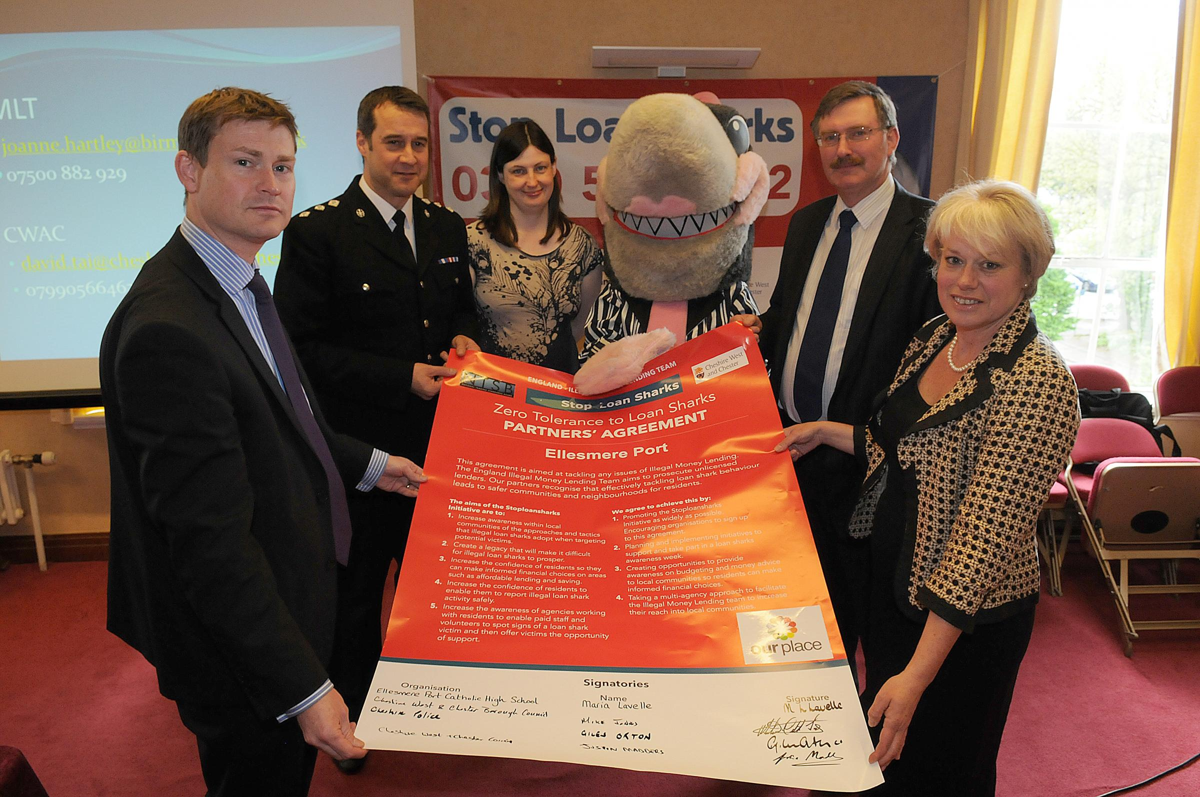 Ellesmere Port Cllr Justin Madders, Chief Inspector Giles Orton, Birmingham Illegal Money Lending Team's Kath Wohler, Glenda the Lender Friendly Shark, CWAC leader Mike Jones and executive member for localities, Cllr Lynn Riley.