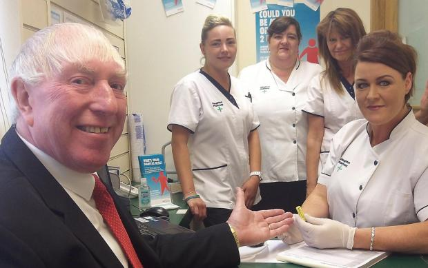 Cllr George Davies prepares to be 'tested' by Lisa Buckley today, watched by pharmacy colleagues Nicky Woods, Barbara Parks and Sandra Bavin. Picture: Craig Manning