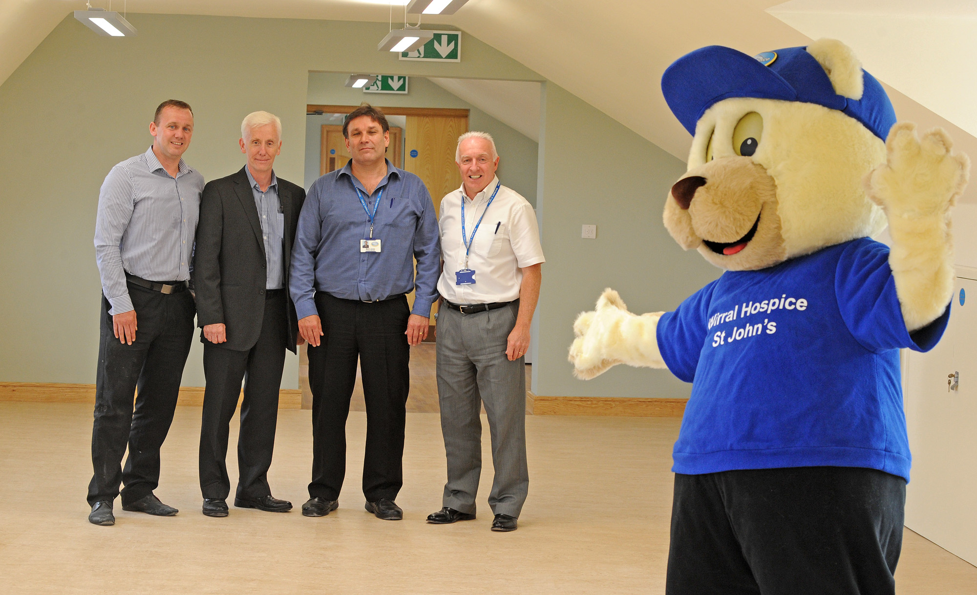 Danny Ambrose, John Nozedar, Mark Jones and Paul Rushbrook with hospice mascot John Bear in the centre today. Picture: Paul Heaps