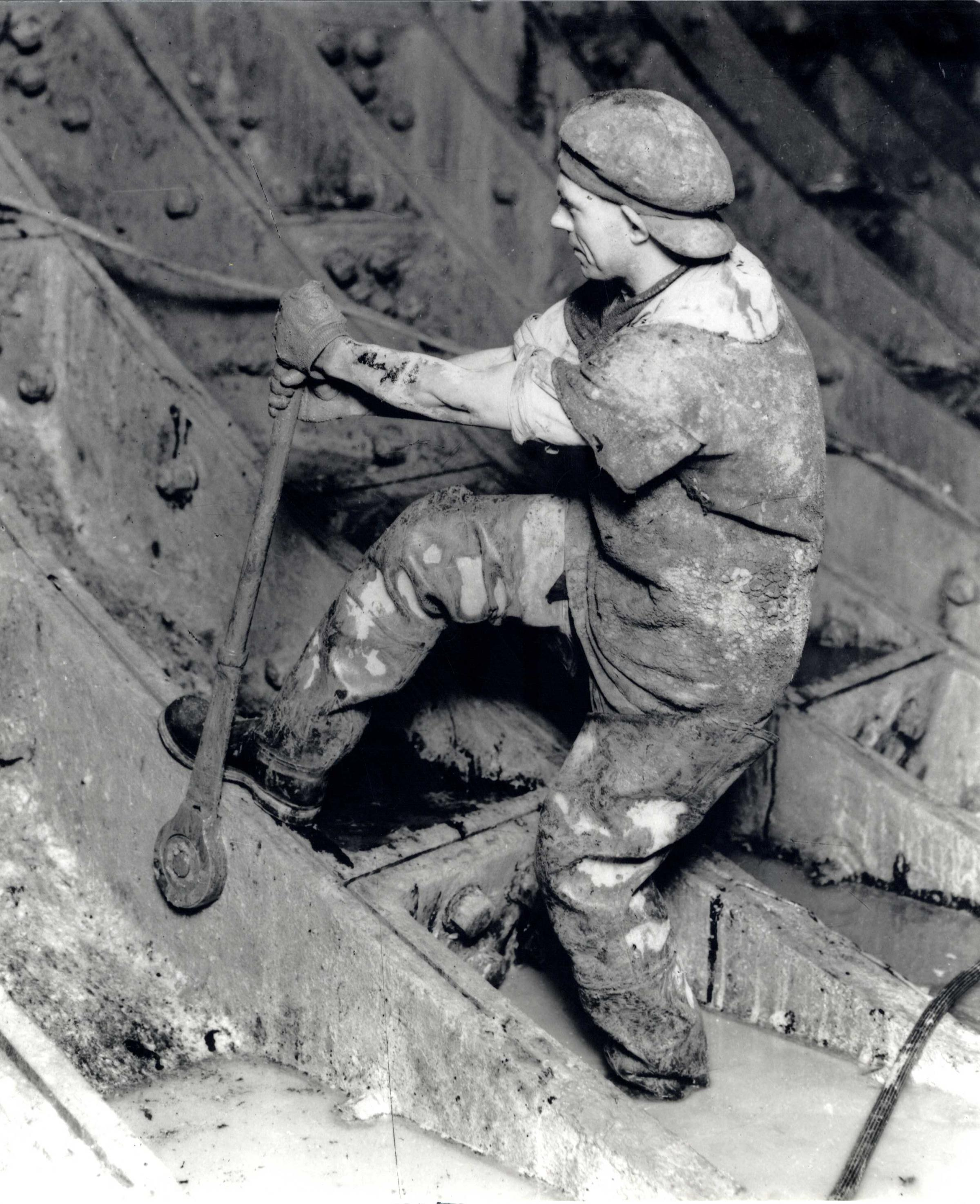 A workman takes the strain during construction of the Queensway Tunnel