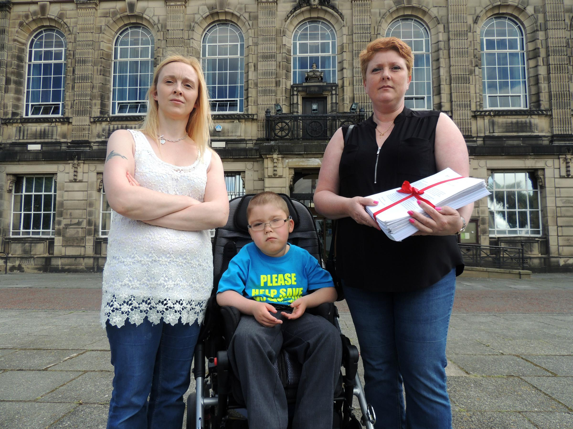 Lyndale parent Chrissie Woodland, her son Alex Bree and fellow parent Maureen Fearon prepare to present the petition to Graham Burgess. Picture by Emma Rigby.