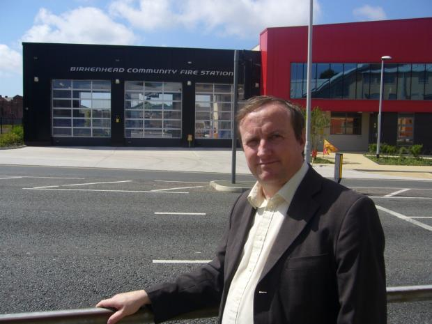 Cllr Stuart Kelly outside Birkenhead Fire Station.