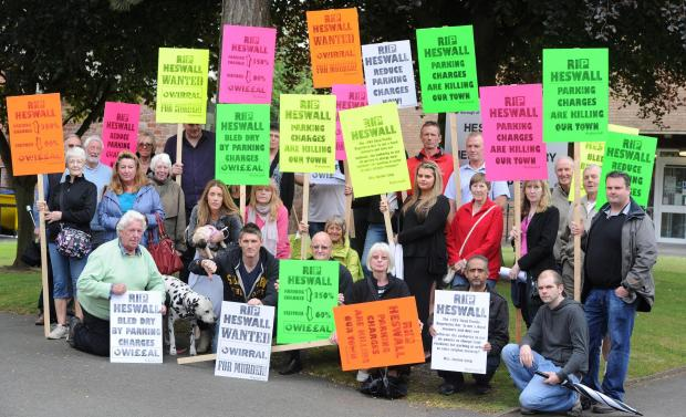 Wirral Globe: Local residents and traders protest outside Heswall Library.