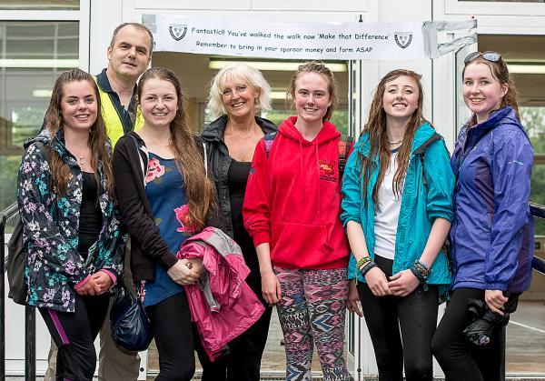 School head teacher Alison Duffy, centre, and geography teacher, Kevin Vane, celebrate with some of the West Kirby Grammar School students as they cross the finishing line at the end of the walk.