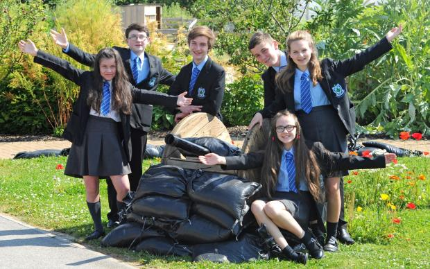 Wirral Globe: Students from Woodchurch High School in the new poppy garden. Pictured from left is, Lucille Ruiz, C